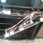 Oven control panel removed to get access to door latch.