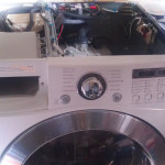 Disassembly of the washer to get to the circulation pump.