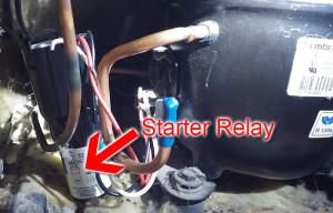 Arrow showing location of Starter Relay inside of Whirlpool Refrigerator Repair.
