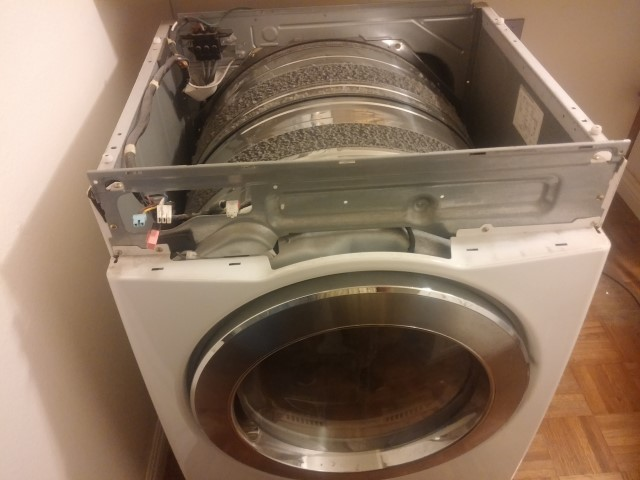 The front panel and top removed from LG Clothes Dryer.