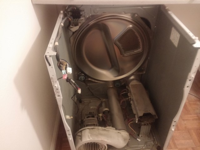 To get to the dryer's motor requires us to almost completely disassemble the clothes dryer.