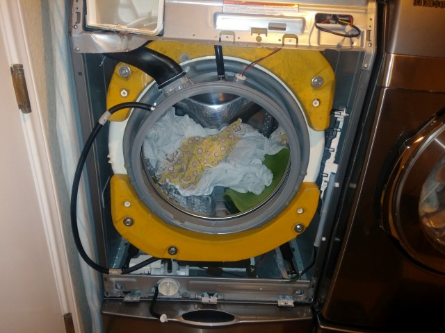 Front cover panel removed to access the inside of the Samsung Washer Gasket Repair.